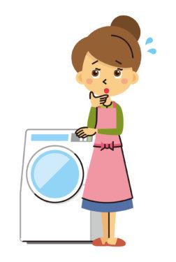 洗濯機と困る主婦
